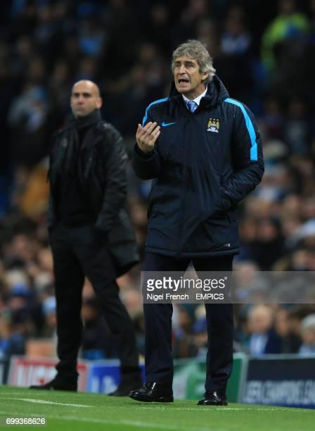 Manchester City manager Manuel Pellegrini alongside Borussia Monchengladbach's coach Andre Schubert.