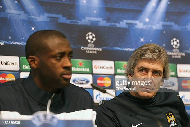 Manchester City manager Manuel Pellegrini and midfielder Yaya Toure listen to questions from the media during a press conference after a training...