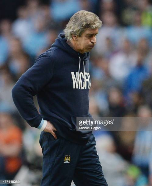 Manchester City manager Manuel Pellegrini looks dejected during the FA Cup QuarterFinal match between Manchester City and Wigan Athletic at the...