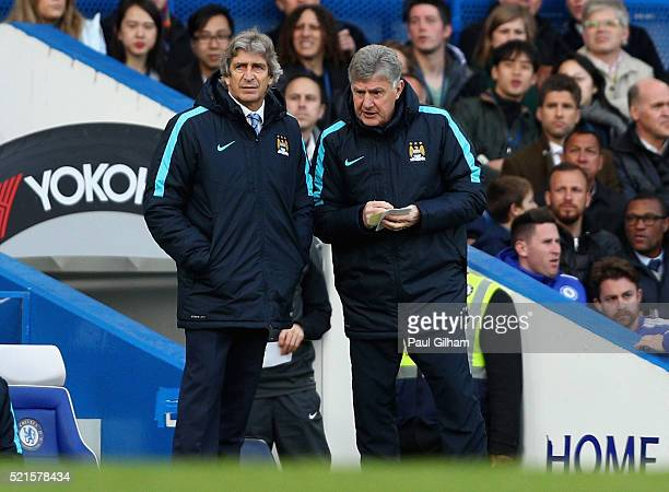 Manchester City manager Manuel Pellegrini speaks with his assistant manager Brian Kidd during the Barclays Premier League match between Chelsea and...