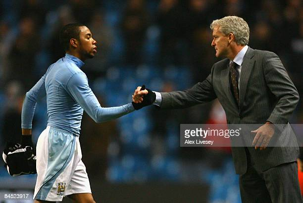 Manchester City Manager Mark Hughes congratulates Robinho at the end of the Barclays Premier League match between Manchester City and Newcastle...