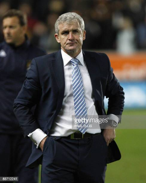 Manchester City manager Mark Hughes leaves the field after the English Premier League football match against Hull City at The Kingston Communications...