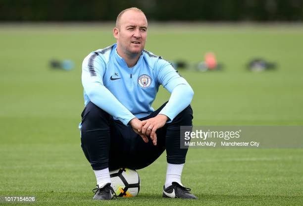 Manchester City manager Nick Cushing sits on the ball during training at Manchester City Football Academy on August 15 2018 in Manchester England