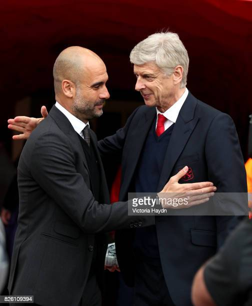 Manchester City manager Pep Guardiola and Arsenal manager Arsene Wenger shake hands before the game
