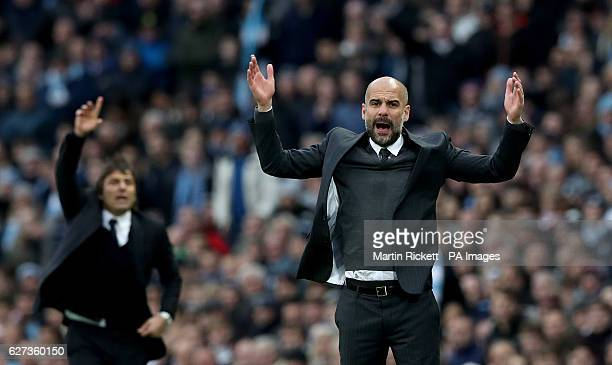 Manchester City manager Pep Guardiola and Chelsea manager Antonio Conte gesture on the touchline during the Premier League match at the Etihad...