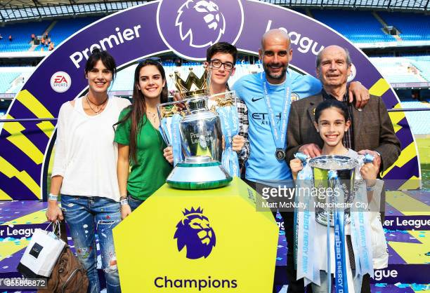Manchester City manager Pep Guardiola and family pose with the Premier League trophy after the Premier League match between Manchester City and...