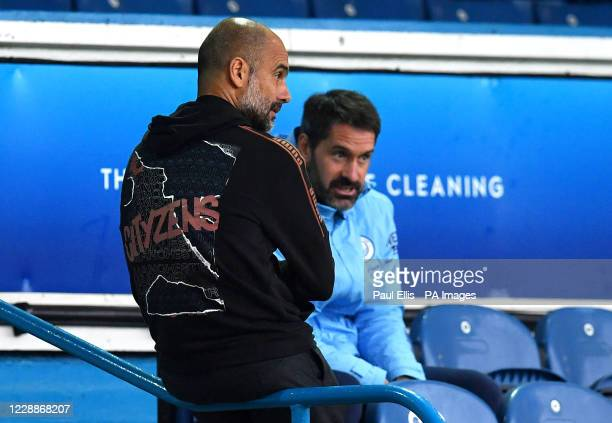 Manchester City manager Pep Guardiola and goalkeeper Scott Carson in discussion before the Premier League match at Elland Road, Leeds.