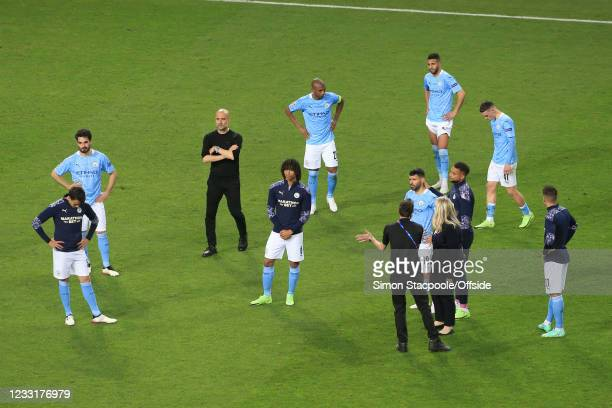 Manchester City manager Pep Guardiola and his players look dejected after the UEFA Champions League Final between Manchester City and Chelsea FC at...