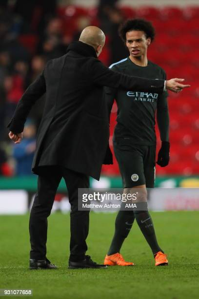 Manchester City manager Pep Guardiola and Leroy Sane of Manchester City during the Premier League match between Stoke City and Manchester City at...