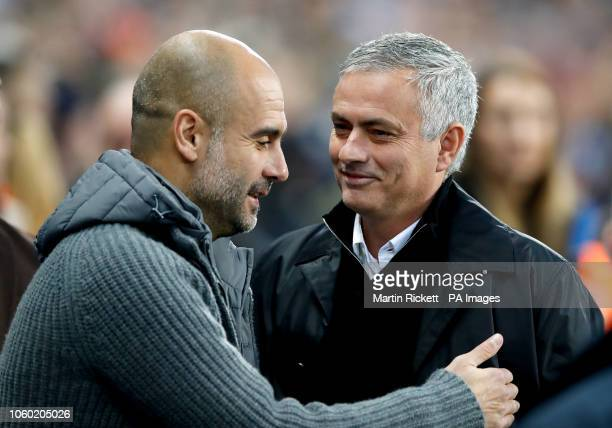 Manchester City manager Pep Guardiola and Manchester United manager Jose Mourinho before kick-offduring the Premier League match at the Etihad...