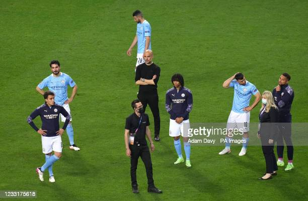 Manchester City manager Pep Guardiola and players after the final whistle during the UEFA Champions League final match held at Estadio do Dragao in...
