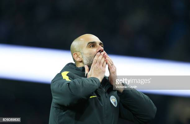Manchester City manager Pep Guardiola celebrates and blow kisses to his family