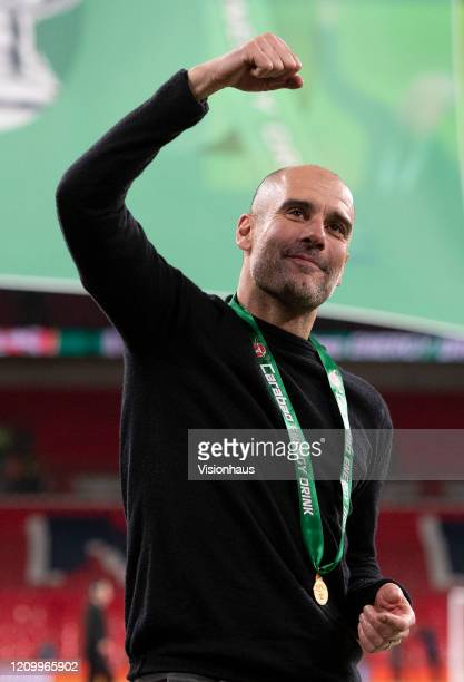 Manchester City Manager Pep Guardiola celebrates victory after the Carabao Cup Final between Aston Villa and Manchester City at Wembley Stadium on...