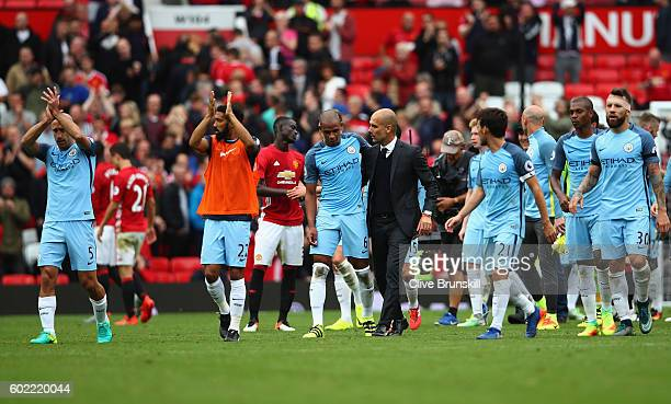 Manchester City manager Pep Guardiola celebrates with Fernando and his team after the final whistle of the Premier League match between Manchester...