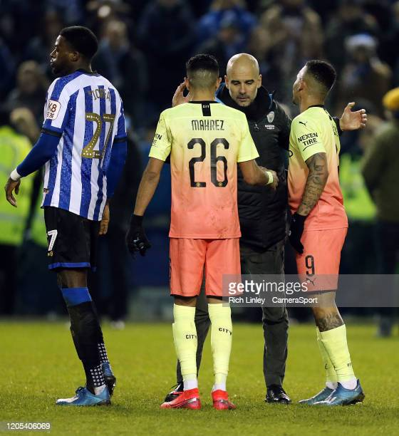 Manchester City manager Pep Guardiola celebrates with Riyad Mahrez and Gabriel Jesus at the final whistle during the FA Cup Fifth Round match between...