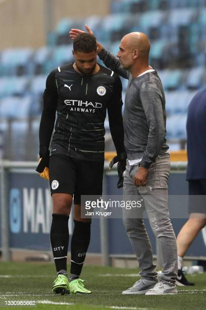 Manchester City manager Pep Guardiola chats with Zack Steffen of Manchester City during a pre-season friendly match between Manchester City and...