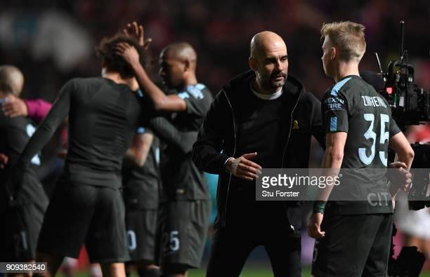 Manchester City manager Pep Guardiola congratulates Oleksandr Zinchenko after the Carabao Cup SemiFinal Second Leg match between Bristol City and...