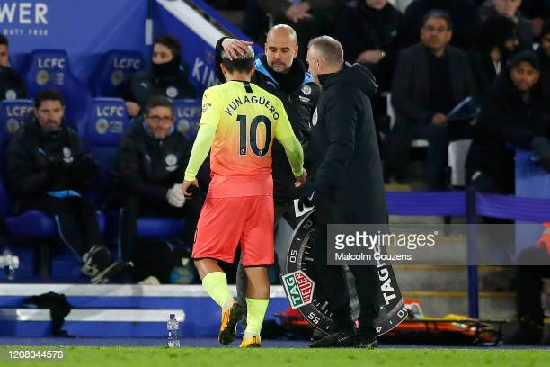 Manchester City manager Pep Guardiola consoles Sergio Aguero following his substitution during the Premier League match between Leicester City and...