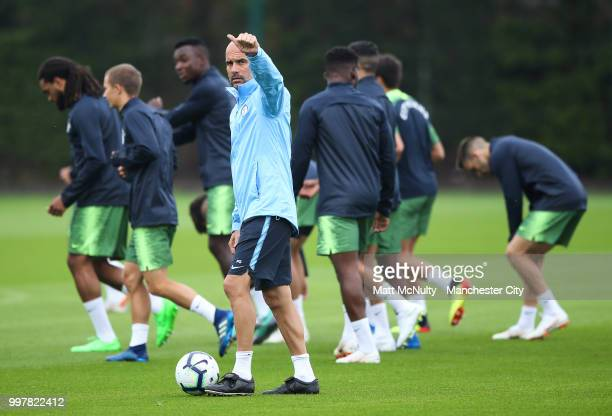 Manchester City manager Pep Guardiola gives a thumbs up during training at Manchester City Football Academy on July 13 2018 in Manchester England