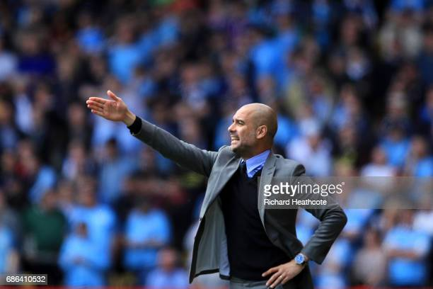 Manchester City manager Pep Guardiola gives instructions during the Premier League match between Watford and Manchester City at Vicarage Road on May...