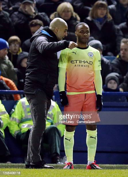 Manchester City manager Pep Guardiola gives instructions to Raheem Sterling before sending him on to replace Sergio Aguero during the FA Cup Fifth...