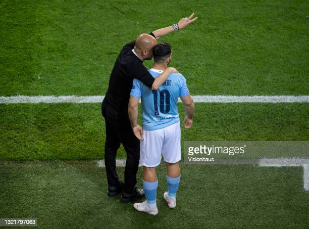 Manchester City manager Pep Guardiola gives instructions to substitute Sergio Agüero during the UEFA Champions League Final between Manchester City...
