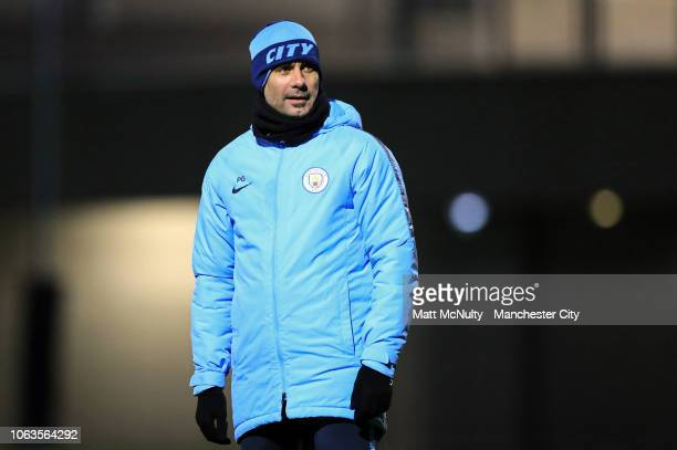 Manchester City manager Pep Guardiola looks on during the training session at Manchester City Football Academy on November 19 2018 in Manchester...