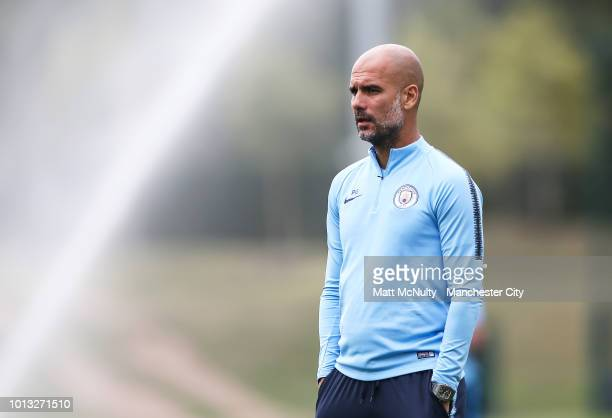 Manchester City manager Pep Guardiola looks on during training at Manchester City Football Academy on August 8 2018 in Manchester England
