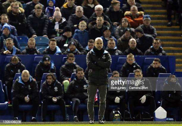 Manchester City manager Pep Guardiola looks on from his technical area during the FA Cup Fifth Round match between Sheffield Wednesday and Manchester...