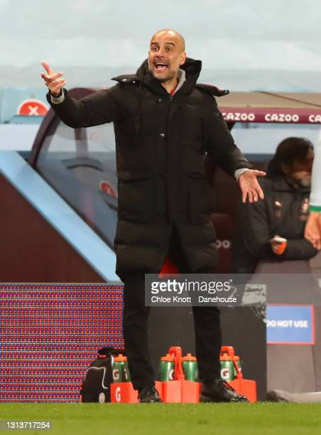 Manchester City Manager Pep Guardiola reacts during the Premier League match between Aston Villa and Manchester City at Villa Park on April 21, 2021...