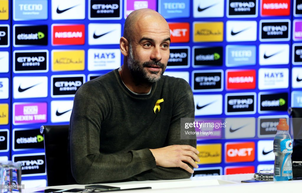 Manchester City manager, Pep Guardiola reacts during the press conference at Manchester City Football Academy on January 12, 2018 in Manchester, England.