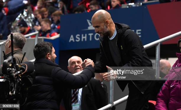 Manchester City manager Pep Guardiola shakes hands with Bristol City manager Gary Johnson before the Carabao Cup SemiFinal Second Leg match between...