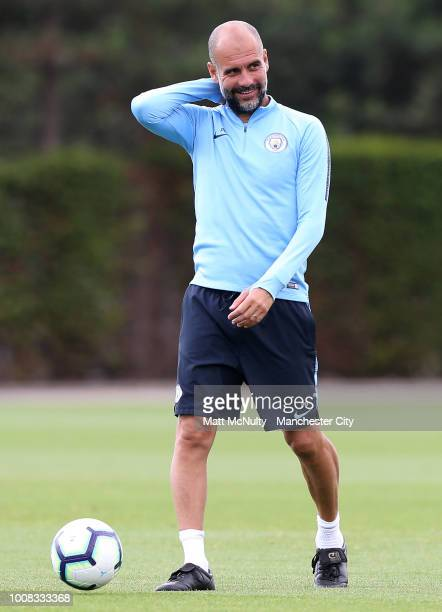 Manchester City manager Pep Guardiola smiles during training at Manchester City Football Academy on July 31 2018 in Manchester England