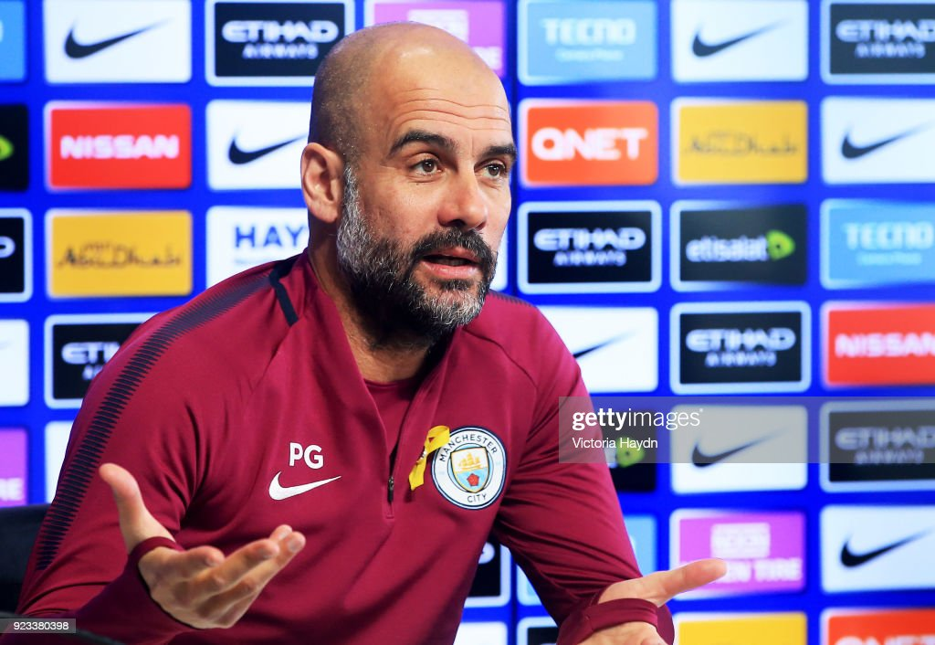 Manchester City manager Pep Guardiola speaks during the press conference at Manchester City Football Academy on February 23, 2018 in Manchester, England.
