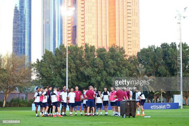 Manchester City manager Pep Guardiola speaks to his players during the training session on March 16 2018 in Abu Dhabi United Arab Emirates
