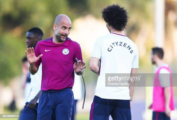 Manchester City manager Pep Guardiola talks with Leroy Sane during the training session on March 16 2018 in Abu Dhabi United Arab Emirates