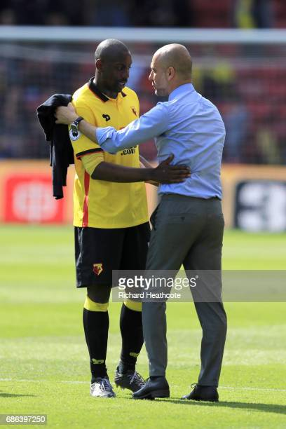 Manchester City manager Pep Guardiola talks with Stefano Okaka of Watford after the Premier League match between Watford and Manchester City at...
