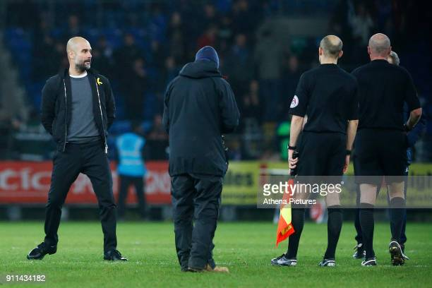 Manchester City manager Pep Guardiola walks away from the match officials after confronting referee Lee Mason after the final whistle of the Fly...