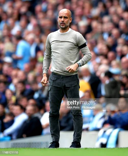 Manchester City manager Pep Guardiola wears a black armband as a sign of respect for the passing of Luis Enrique's daughter Xana during the Premier...