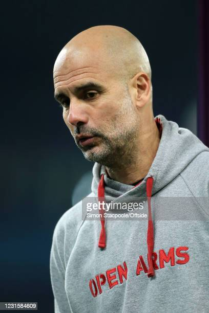 Manchester City manager Pep Guardiola wears a hoodie bearing the 'Open Arms' logo after the Premier League match between Manchester City and...