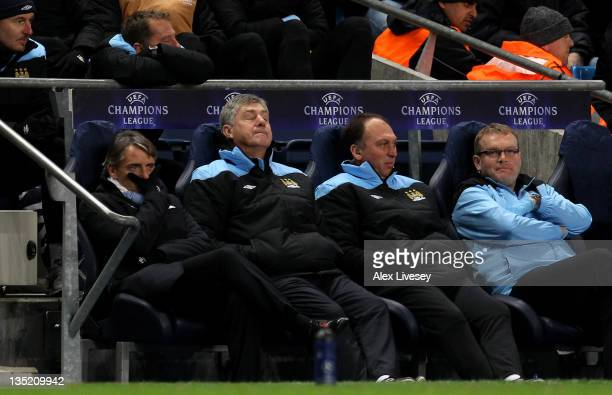 Manchester City Manager Roberto Mancini and Asistants Brian Kidd and David Platt look dejected during the UEFA Champions League Group A match between...