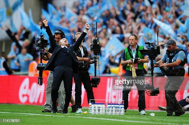 Manchester City Manager Roberto Mancini celebrates at the final whistle as his team win the FA Cup sponsored by EON Final match between Manchester...