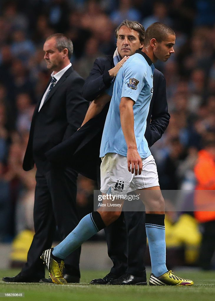 Manchester City Manager Roberto Mancini congratulates Jack Rodwell as he is substituted during the Barclays Premier League match between Manchester City and West Bromwich Albion at the Etihad Stadium on May 07, 2013 in Manchester, England.