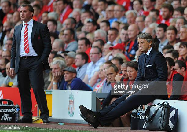 Manchester City Manager Roberto Mancini looks on during the Barclays Premier League match between Liverpool and Manchester City at Anfield on August...