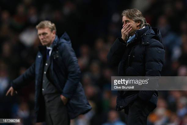 Manchester City Manager Roberto Mancini looks on during the Barclays Premier League match between Manchester City and Everton at the Etihad Stadium...
