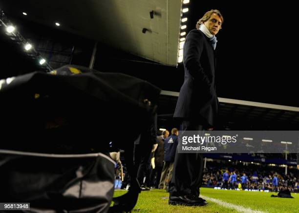 Manchester City Manager Roberto Mancini looks on prior to the Barclays Premier League match between Everton and Manchester City at Goodison Park on...