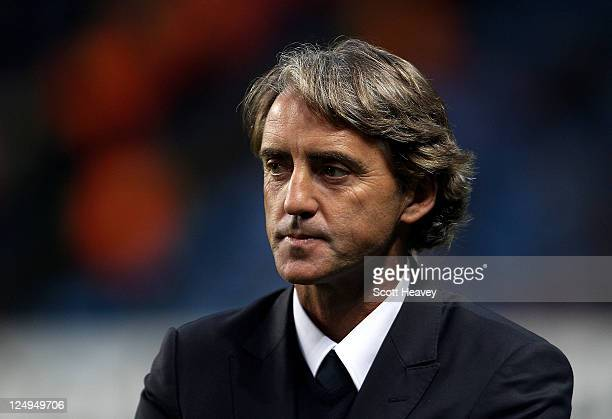 Manchester City Manager Roberto Mancini looks on prior to the UEFA Champions League Group A match between Manchester City and SSC Napoli at the...