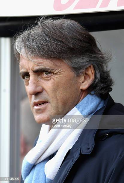 Manchester City manager Roberto Mancini looks thoughtful ahead of the Barclays Premier League match between Swansea City and Manchester City at the...