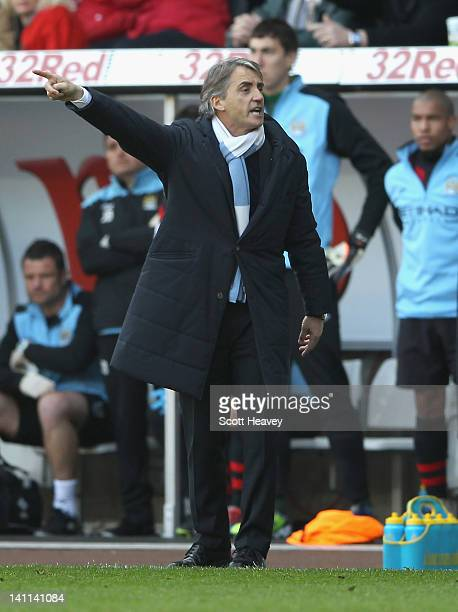 Manchester City manager Roberto Mancini reacts during the Barclays Premier League match between Swansea City and Manchester City at the Liberty...