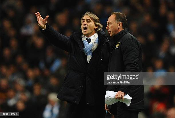 Manchester City Manager Roberto Mancini reacts with Assistant David Platt during the Barclays Premier League match between Manchester City and...